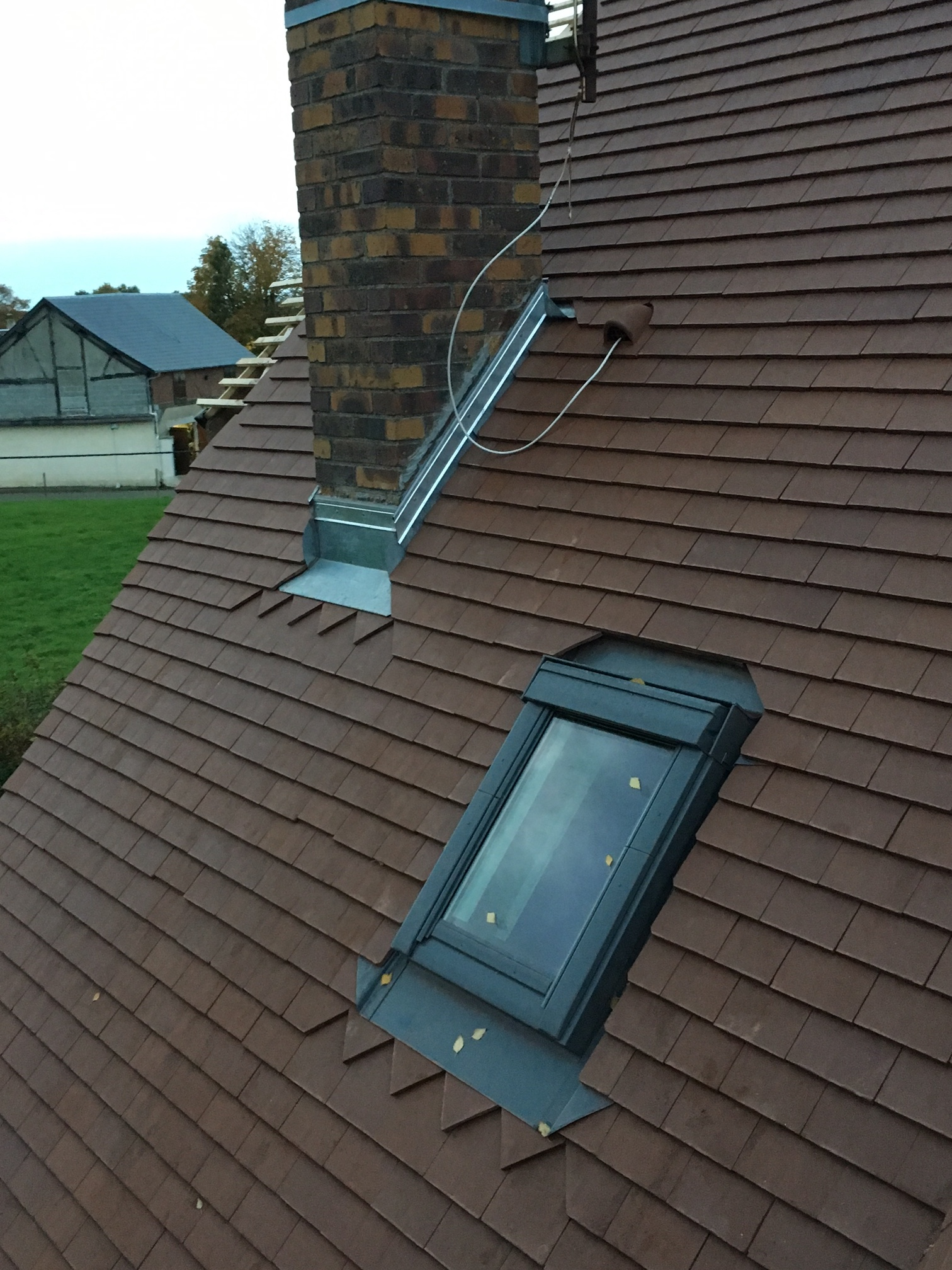 Réalisation d'une toiture à Flipou (27) en tuiles plates